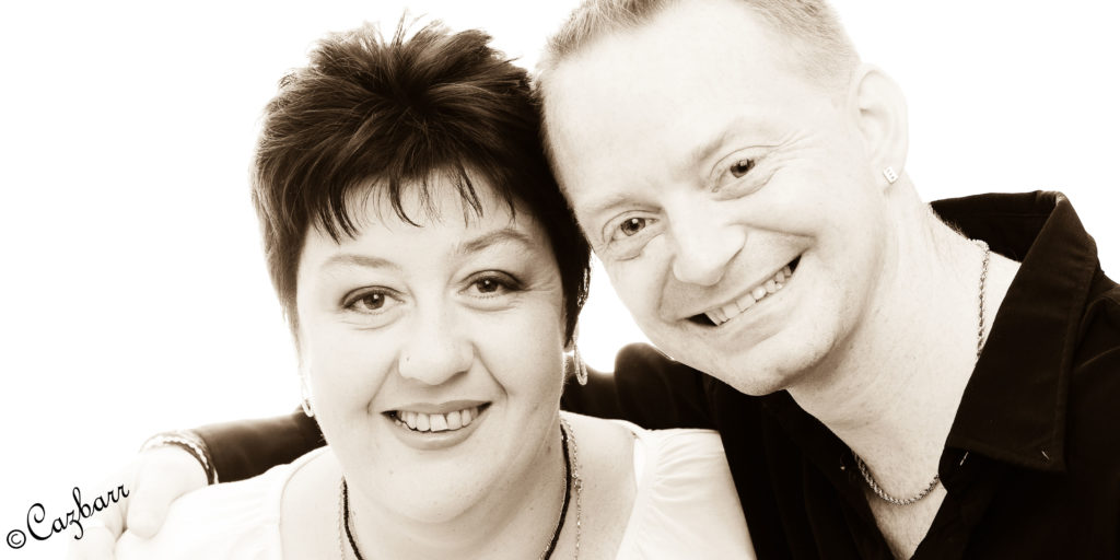 Black & white head shot of Cazbarr and her husband Jeff