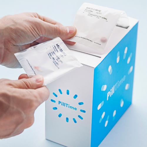 PillTime:  Home Deliver Pharmacy Service  -  Strip of pills being pulled out of a box