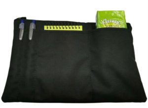 Black wheelchair armrest pouch with one main pocket and several smaller ones
