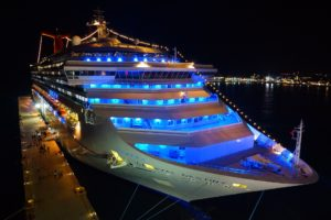 Front of cruise ship with blue interior lights