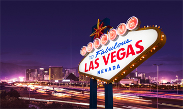 Big street sign with Las Vegas all lit up