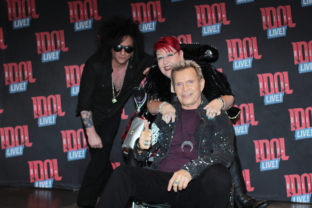 Las Vegas:  My First Time Flying As A Full-Time Wheelchair User -Billy Idol sitting on my footrest between my legs while I'm sitting in my wheelchair