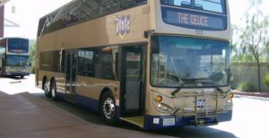 Las Vegas:  My First Time Flying As A Full-Time Wheelchair User -Gold & blue double decker bus that runs up & down the Vegas strip
