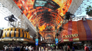 Freemont Street in Vegas with overhead cover all lit up with flame images