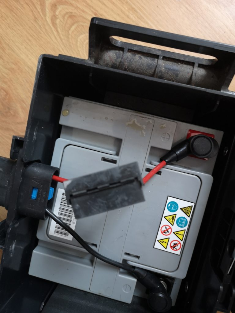 """NHS Wheelchair Service: Is Yours """"Fit For Purpose""""? Electric wheelchair battery sitting inside hard plastic box"""