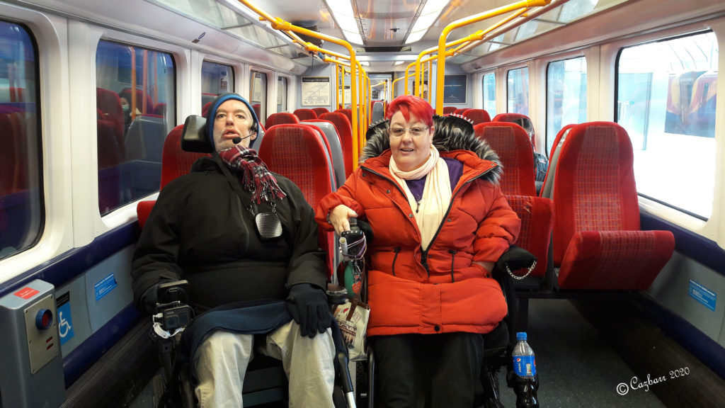 Wheelchair user travels on a train for 1st time!! - Alan and myself sat in our wheelchairs in the disabled spaces on the train.