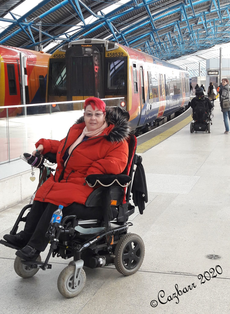 Wheelchair user travels on a train for 1st time!! - Cazbarr sat on the platform in front of a parked train.