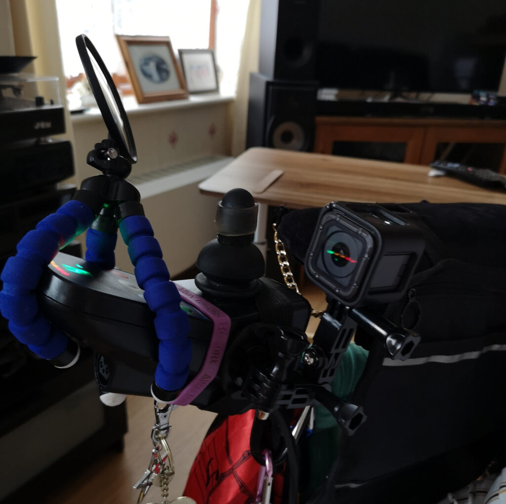 Wheelchair controller with mirror and Go Pro