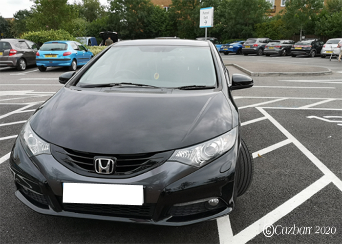 Car parked in a disabled bay with no blue badge on display