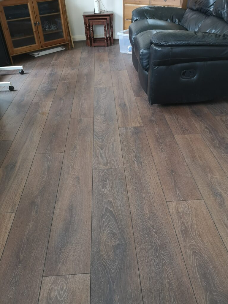 Our new living room laminate flooring in dark brown wood