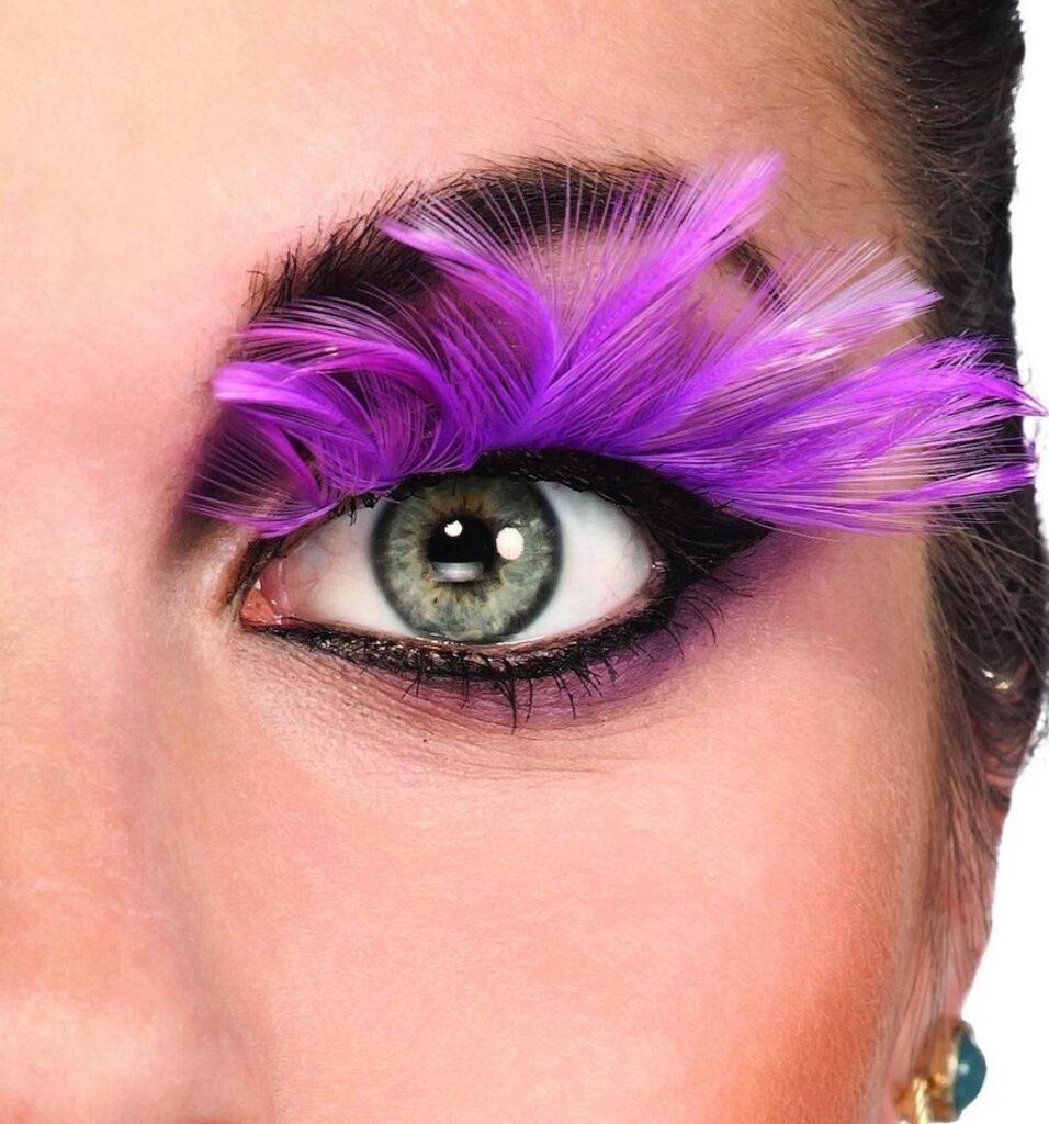 False Eyelashes:  That Work With Poor Dexterity - An eye wearing pink feather false eyelashes