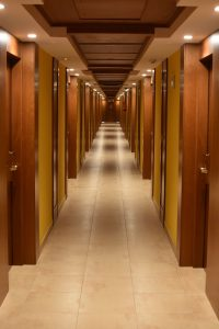 Hotels Don't Offer Accessible Family Rooms, Is This Discrimination? - Long hotel corridor.