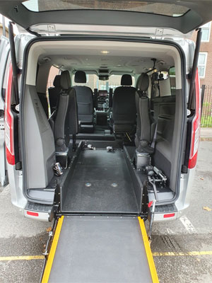 Wheelchair accessible vehicle with ramp deployed