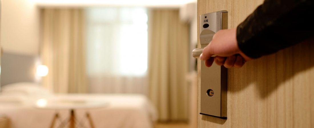 Hotel room door being opened